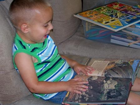 "Adam, sitting on the sofa during Quiet Time with his ""Quiet Time"" box and one of his favorite ""Quiet Time Books"