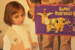 """Cassidy waits for her turn in """"Pin the Tail on the Donkey"""""""